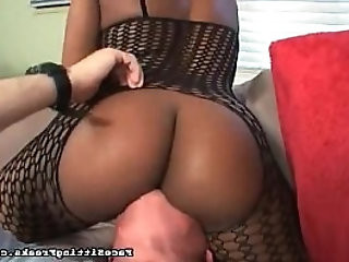 His head is buried in her black ass
