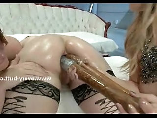 Gorgeous whores have their asses pluged