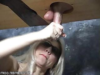 Mistress masturbates a cock through a gloryhole