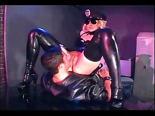 Uniformed female cop fucking in latex lingerie