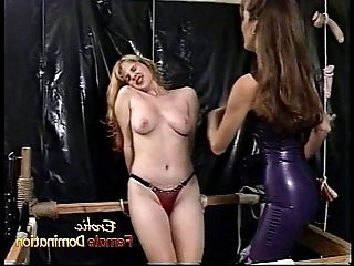 Raunchy blonde slut with big tits and gets hard by a dominatrix