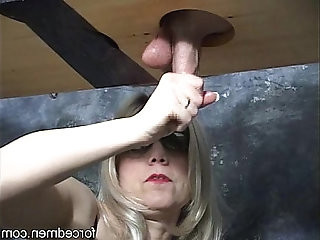 Mistress masturbates a cock through a gloryhole